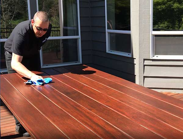 Nova Blog Wiping down a Tigerwood Table with ExoShield after Two Years