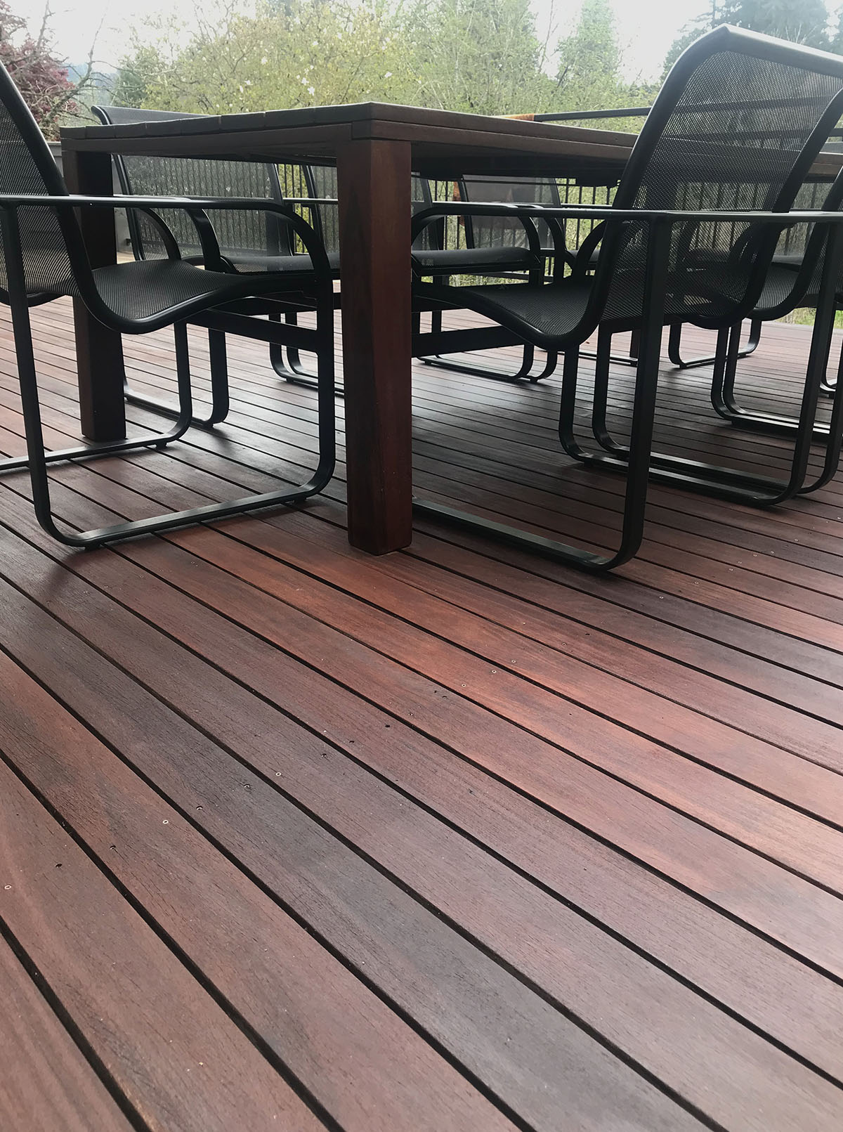 ExoShield Walnut on 10 year old 1x4 Cumaru Hardwood Deck
