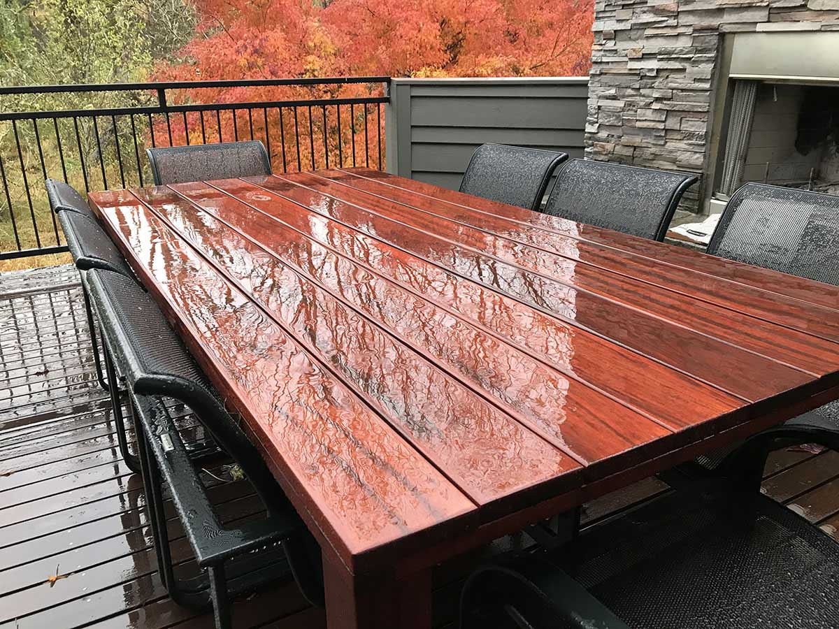 ExoShield Treated TigerWood Table shown in Rain after 6 months